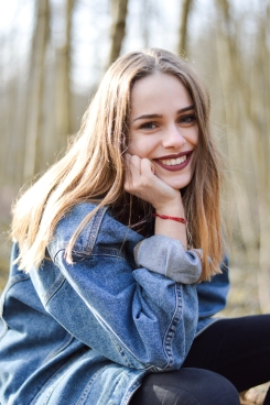 girl-shooting-wood-blue-jean-bnsphotography